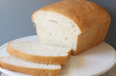 loaf of white bread on a white plate