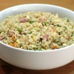 White bowl full of an easy fried rice recipe on top of wooden table