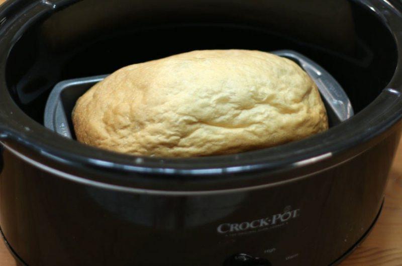 easy crock pot bread recipe bread baking in a black crock pot