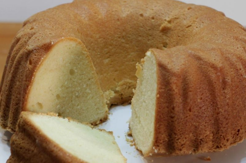 easy homemade pound cake sitting on a white plate on a table