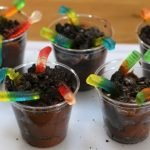 worms in dirt dessert with gummy worms coming out of oreo cookie and pudding in a cup