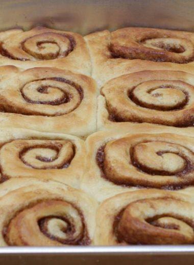 no knead cinnamon rolls recipe in a large baking pan