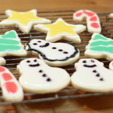 easy sugar cookies decorated and resting on a wire rack