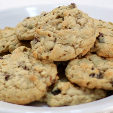 White plate full of homemade chewy oatmeal raisin cookies