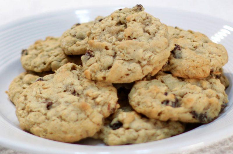 White plate full of homemade chewy oatmeal raisin cookies