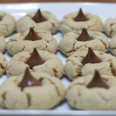 Peanut butter blossoms cookies on a white plate