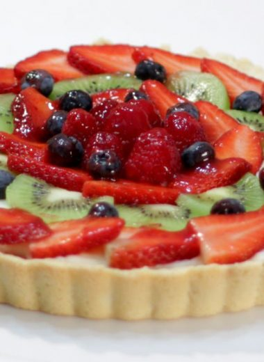 Fruit tart on a white cake pedestal