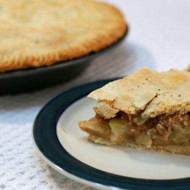slice of easy apple pie next to another pie.