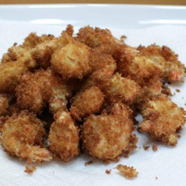 easy crispy fried shrimp piled on a white plate