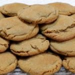 soft chewy molasses cookies piled on a wire rack