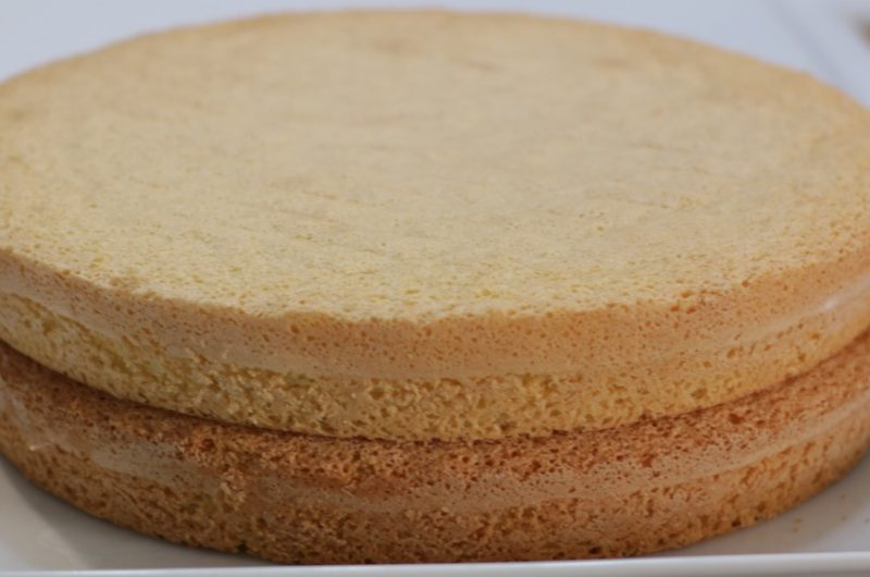 easy 3-ingredient sponge cake layered on a white plate