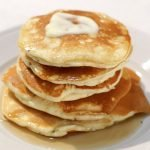 Stack of easy fluffy pancakes on a white plate