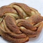 Cinnamon roll twist bread on a cake pedestal