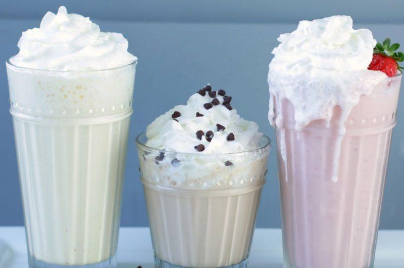 Three homemade milkshakes on a plate.