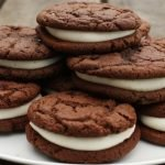 homemade whoopie pies on a plate on picnic table