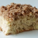 Apple streusel coffee cake on a white plate