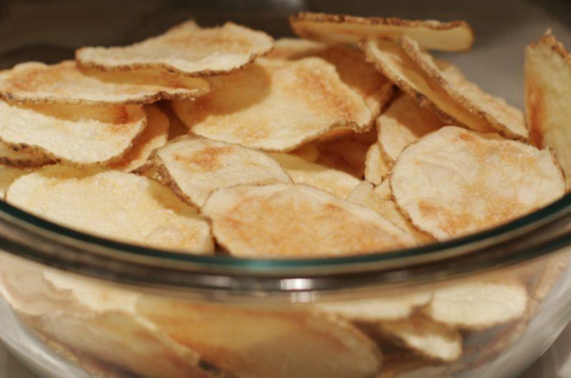 Crispy microwave potato chips in a glass bowl
