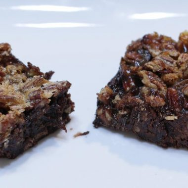2 pecan pie brownies on a white plate