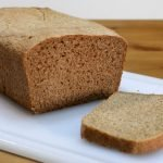 Whole wheat bread on a white cutting board