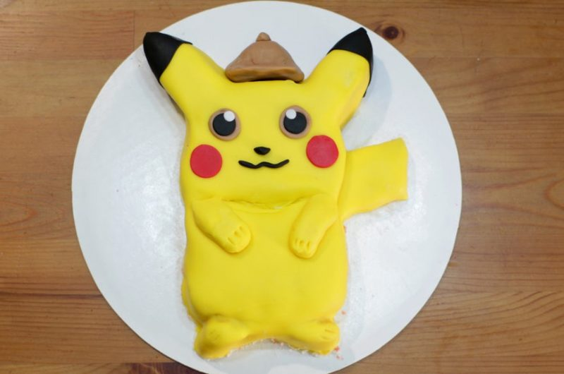 Pokemon detective pikachu cake on a white cake board