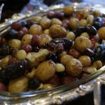 roasted baby potatoes in silver plate on table.