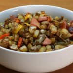 White bowl full of country fried potatoes