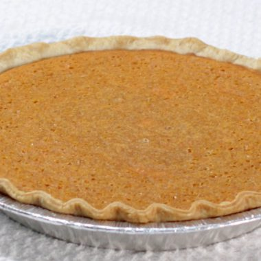 Sweet potato pie on a white table.