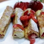 French toast roll ups on a white plate