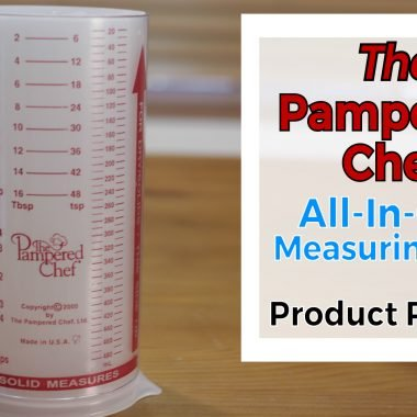 Pampered chef measure all measuring cup on top of a wooden table.