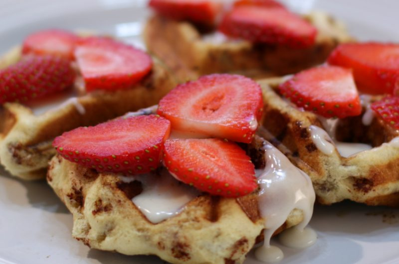 cinnamon roll waffles on a white plate
