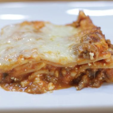 Easy homemade lasagna on a white plate.