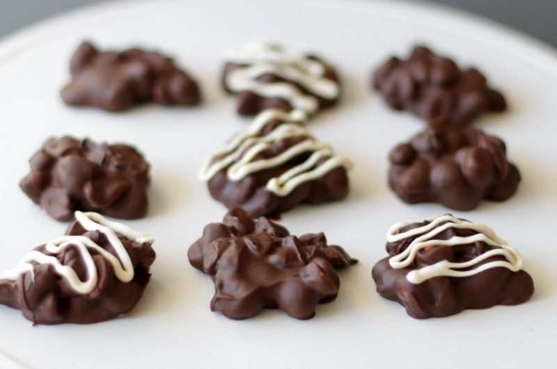 chocolate peanut clusters on a white plate