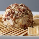Easy cheese ball on a plate with crackers