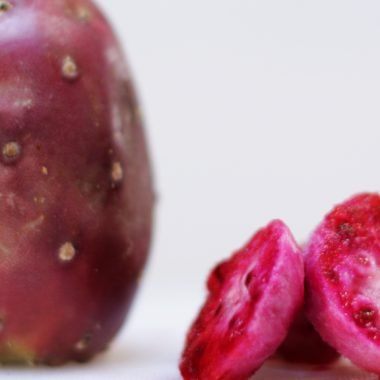 prickly pear on a white cutting board on a table.