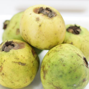 Pile of Mexican Guavas on a white plate.