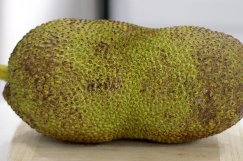 Large jackfruit on a countertop.