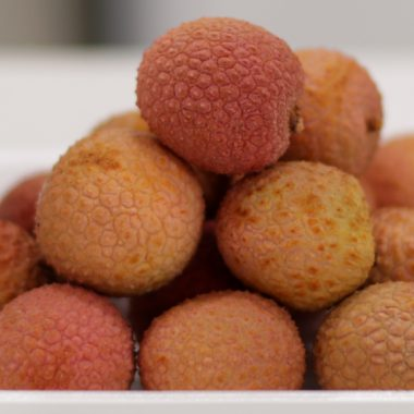 stack of lychee on a white plate