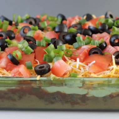 glass dish filled with 7 layer bean dip