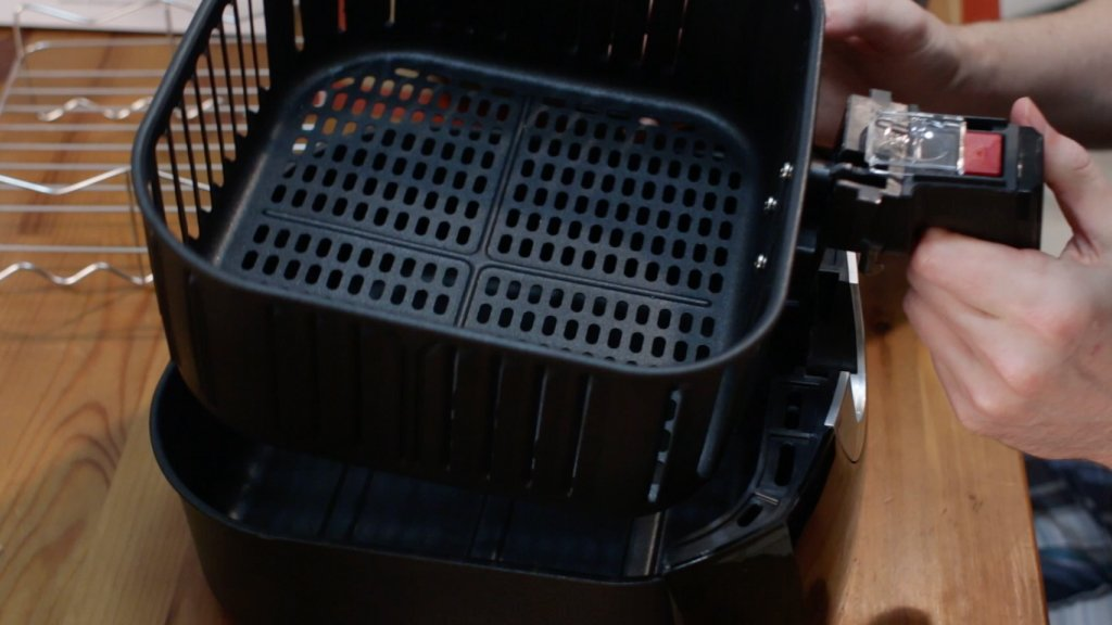 Two parts of air fryer basket.