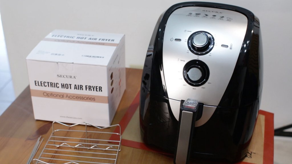 Secura air fryer on a table.