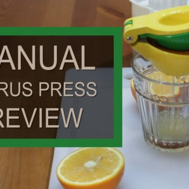 Zulay manual citrus press squeezing an orange