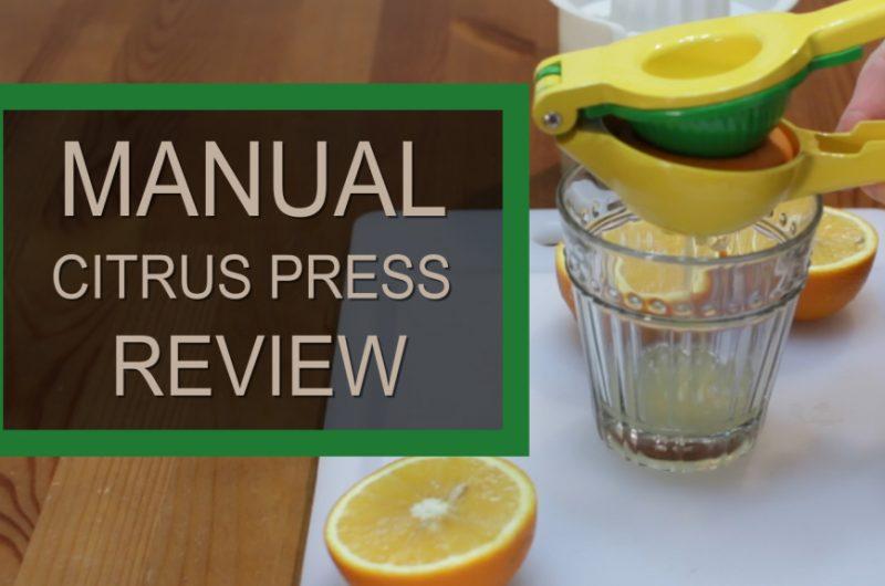 Zulay manual citrus press squeezing an orange