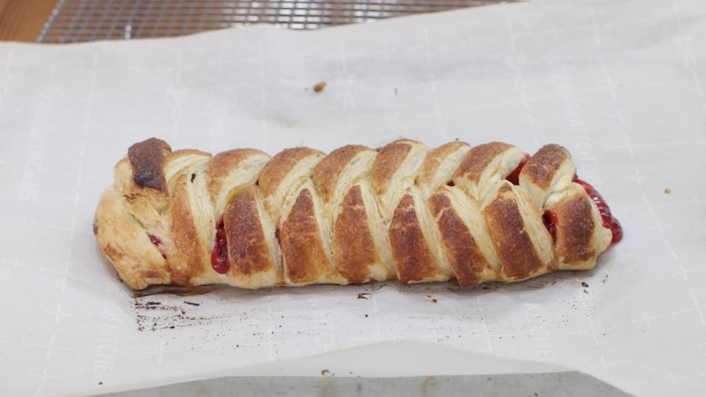 Freshly baked pastry on a sheet pan with parchment paper.