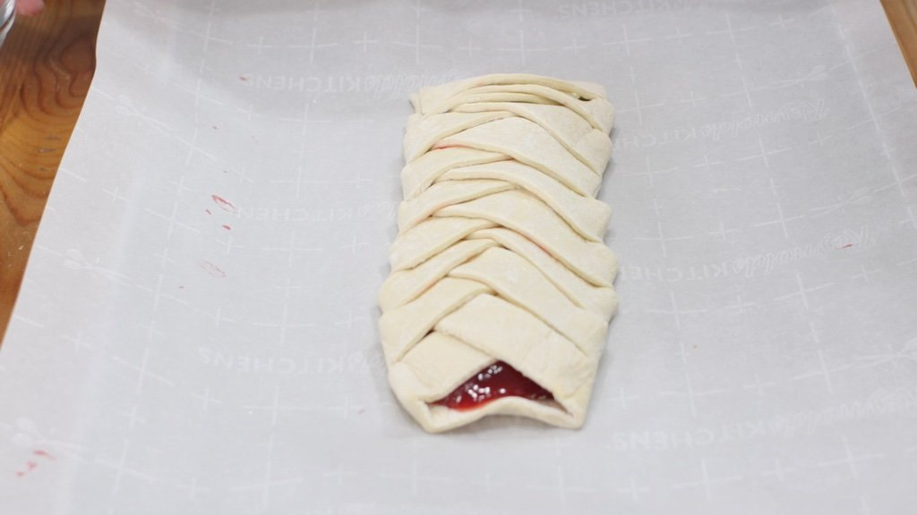 Braided strawberry puff pastry ready to be baked.