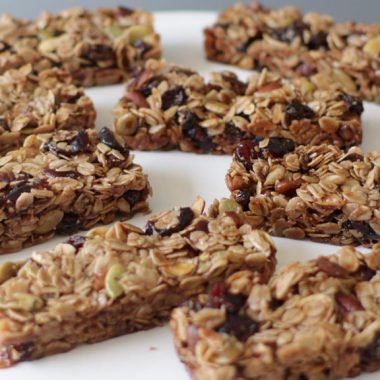 Several homemade granola bars on a white plate