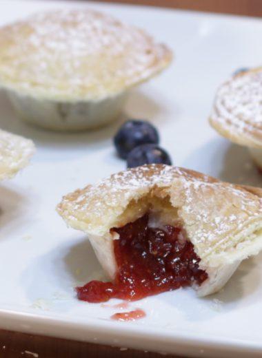 Four mini pies on a white plate