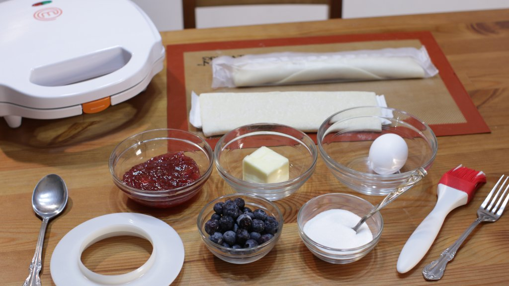 Several ingredients on a table in glass bowls.