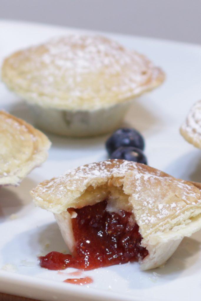 A few mini pies on a white plate.