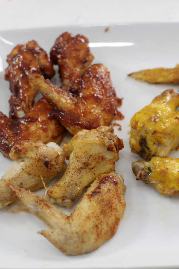 Air fryer chicken wings on a white plate.