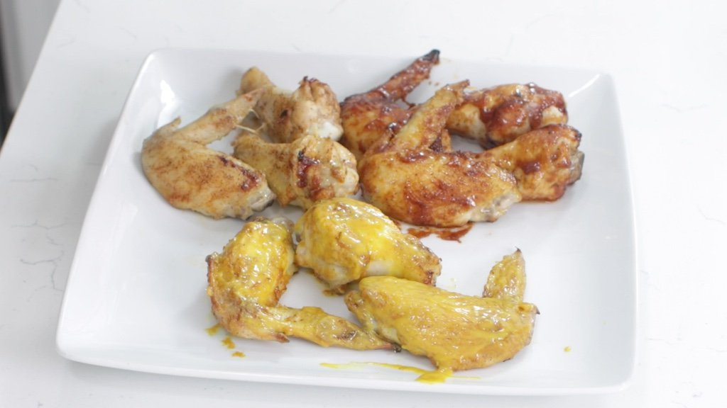 Plate of finished chicken wings cooked in the air fryer.